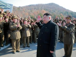 This undated picture released by North Korea's Korean Central News Agency (KCNA) via KNS on March 7, 2017 shows North Korean leader Kim Jong-Un waving to North Korean officers during the launch of four ballistic missiles.