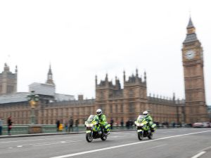 Police on motorcycles ride across Westminster Bridge away from the Houses of Parliament in central London on March 23, 2017 after the bridge reopened to traffic following its closure during the March 22 terror attack. Britain's parliament reopened on Thursday with a minute's silence in a gesture of defiance a day after an attacker sowed terror in the heart of Westminster, killing three people before being shot dead. Sombre-looking lawmakers in a packed House of Commons chamber bowed their heads and police officers also marked the silence standing outside the headquarters of London's Metropolitan Police nearby. / AFP PHOTO / Adrian DENNIS