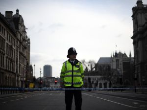 LONDON, ENGLAND - MARCH 23: A police officer mans a cordon near Parliament Square following yesterday's attack, on March 23, 2017 in London, England. Four people including the assailant have been killed and around 40 people injured following yesterday's attack by the Houses of Parliament in Westminster.