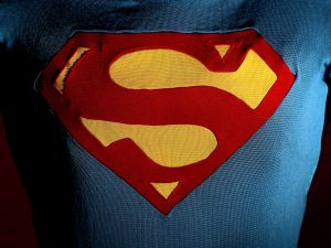 The Superman costume as worn by Christopher Reeve in Superman III displayed at the Auction House of Bonhams and Goodman.