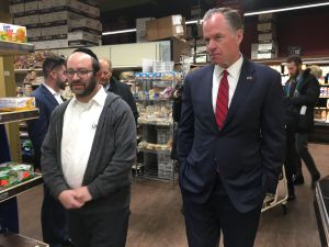 GOP mayoral candidate Paul Massey with the manager of Kissena Farms Kosher Supermarket.