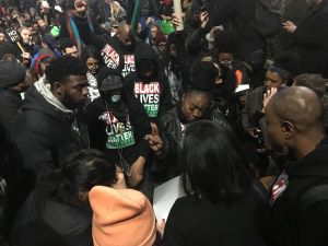 Members of Black Lives Matter New York at a rally to honor Timothy Caughman, a black man who was murdered by a white supremacist.