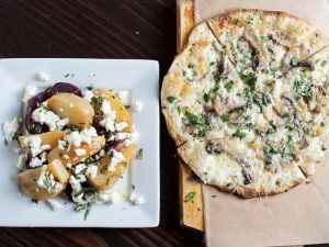 Bacari GDL serves pizzas baked in a wood-fired stone oven.