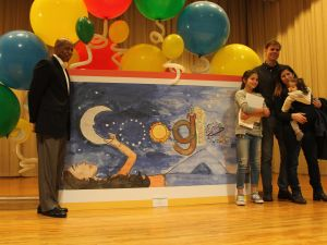 Brooklyn Borough President Eric Adams stands with Gwendolyn McNamara and her family.