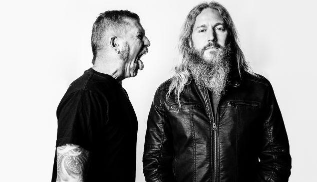 Bill Kelliher (short hair) and Troy Sanders (long hair) of the band Mastodon
