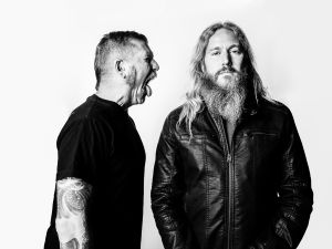 Bill Kelliher (short hair) and Troy Sanders (long hair) of the band Mastodon