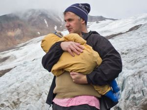 Phil Elverum holds his daughter.