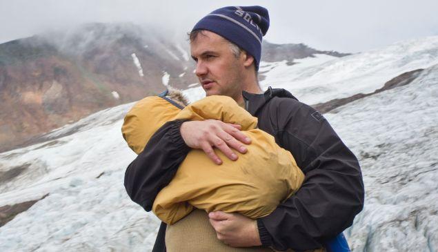Phil Elverum holds his daughter.