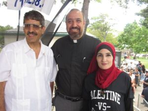 Rev. Khader El-Yateem, center, with supporter Linda Sarsour.