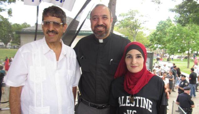 Rev. Khader El-Yateem, center, with supporter Linda Sarsour.