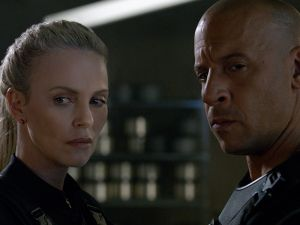 Charlize Theron as Cipher and Vin Diesel as Dom Toretto.