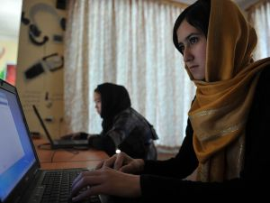 In this picture taken on July 22, 2012, Afghan women use computers at the Young Women For Change internet cafe, Afghanistan's first women-only net cafe, in Kabul. Ten years after the fall of the Taliban, who banned modern technology as un-Islamic, social media in Afghanistan are booming as politicians, warlords -- even the militants themselves -- rush to get their message across.