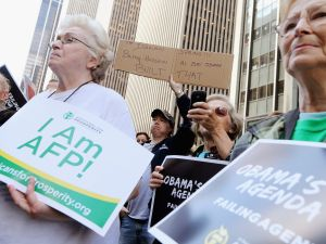 Americans for Prosperity members rallying in September.