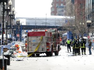 BOSTON, MA - APRIL 15: Firefighters take postion on Boyltson Street near the finish line after two bombs exploded during the 117th Boston Marathon on April 15, 2013 in Boston, Massachusetts. Two people are confirmed dead and at least 28 injured after at least two explosions went off near the finish line to the marathon.
