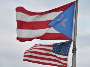 The Puerto Rican and US flags are seen in the Old Town district in San Juan, Puerto Rico.