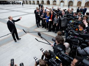 Russian President Vladimir Putin speaks with journalists in central Moscow.