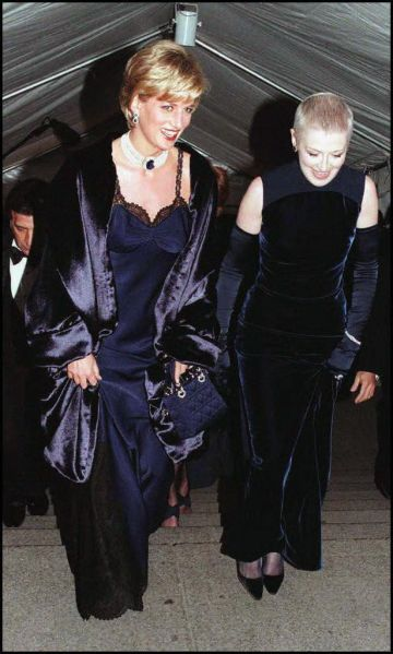 Does it get more iconic than Princess Diana? Here she is arriving with her friend and editor, Liz Tilberis.