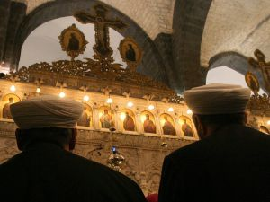 Two Muslim clerics attend a mass at the Mariamiyah Church in Damascus.