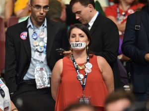 A supporter of former Democratic presidential candidate Bernie Sanders stands in silent protest during the Democratic National Convention on July 25, 2016.