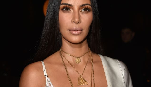 Kim Kardashian in Kanye's first fine jewelry collection.