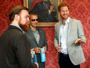 Prince Harry chats with US veteran Ivan Castro (C) and UK veteran Karl Hinett (L) who will run the Boston and London Marathons for the Heads Together Campaign, after he attending a conference at King's College on March 16, 2017 in London, England. Prince Harry attended the Veterans' Mental Health Conference where he led a panel discussion with three veterans on the benefits of having open conversations and getting the right support for a range of mental health issues. (Photo by Kirsty Wigglesworth/WPA Pool/Getty Images)