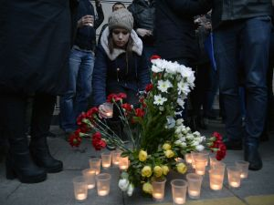 "People place flowers and lit candles in memory of victims of the blast in the Saint Petersburg metro outside Sennaya Square station on April 3, 2017. Ten people were killed and several more injured Monday after an explosion rocked the metro system in Russia's second city Saint Petersburg, and authorities launched a probe into suspected ""act of terror"". / AFP PHOTO / Olga MALTSEVA (Photo credit should read OLGA MALTSEVA/AFP/Getty Images)"