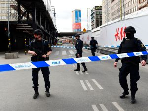 Police officers cordon off the scene where a truck crashed into the Ahlens department store at Drottninggatan in central Stockholm, April 7, 2017. / AFP PHOTO / Jonathan NACKSTRAND (Photo credit should read JONATHAN NACKSTRAND/AFP/Getty Images)