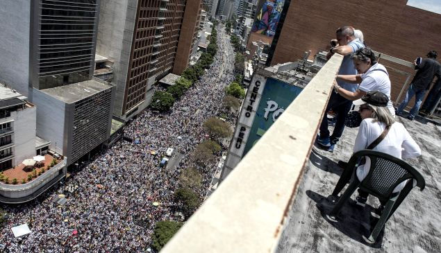 Thousands of demonstrators protesting against President Nicolas Maduro's government march in Caracas on April 8, 2017.