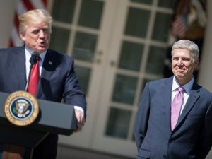 Neil Gorsuch (R) listens as US President Donald Trump speaks during a ceremony in the Rose Garden of the White House April 10, 2017 in Washington, DC.
