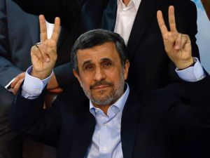 Former Iranian president Mahmoud Ahmadinejad flashes the sign for victory at the Interior Ministry's election headquarters as candidates begin to sign up for the upcoming presidential elections in Tehran on April 12, 2017.