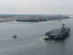 USS Gerald R. Ford arrives at Naval Station Norfolk and approaches its berth next to the Nimitz-class aircraft carriers USS Dwight D. Eisenhower left, and USS George Washington after returning from Builder's Sea Trials and seven days underway.