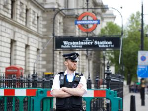 A British police officer secures a cordon outside an entry to Westminster underground station on Whitehall near the Houses of Parliament in central London on April 27, 2017, near the scene where a man was detained and taken away by police.