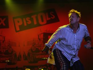 NEWPORT, UNITED KINGDOM - JUNE 14: John Lydon of the Sex Pistols performs at the Isle of Wight Festival June 14, 2008 in Newport, Isle of Wight, England. The festival, attended by 50,000 music fans, which features headline acts The Kaiser Chiefs, Sex Pistols and The Police, is in its seventh year after being reincarnated in 2002. The promoters claim their aim is to recreate the hippy spirit of the famous festivals held on the island in the late 1960s, when thousands of music fans watched acts such as Jimi Hendrix, the Doors and Bob Dylan. (Photo by Matt Cardy/Getty Images)
