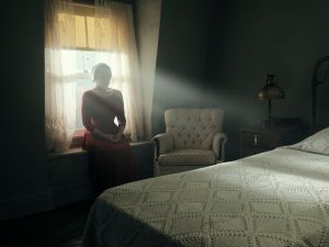 """The Handmaid's Tale -- """"Offred"""" Episode 101 -- Offred, one the few fertile women known as Handmaids in the oppressive Republic of Gilead, struggles to survive as a reproductive surrogate for a powerful Commander and his resentful wife. Offred (Elisabeth Moss), shown. (Photo by: George Kraychyk/Hulu)"""