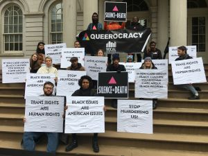 LGBTQ and black advocates rallied in front of City Hall this morning.