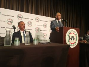 Former U.S. Attorney General Eric Holder and the Rev. Al Sharpton at the National Action Network Convention.