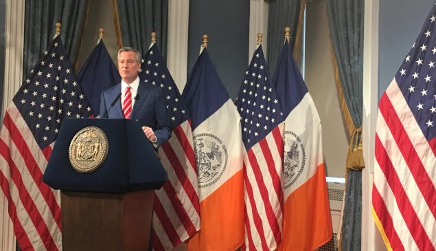 Mayor Bill de Blasio discusses his $84.86 billion executive budget in the Blue Room at City Hall.