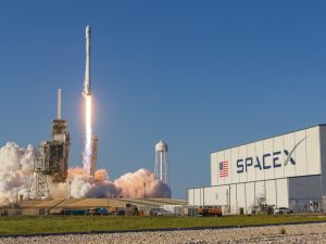 A SpaceX 'flight-proven' Falcon 9 rocket lifts off from Kennedy Space Center.