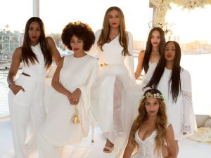 "Tina Knowles wed Richard Lawson in 2015, wearing Romona Keveza. ""The dress is an ivory five-ply silk crepe column with our signature asymmetrical one shoulder neckline and side front high slit. Tina wore it with an illusion tulle over skirt, our Italian made metal belt and our house signature evening shrug. ""I've honestly never seen her look better. Being a fashion designer herself it was an honor to dress her- she's such a fashionista but also so modern. This dress is timeless and ageless and checked off all of the right boxes for her - it has a great fashion quotient and sex appeal but feels modern and timeless and inspired by ready-to-wear. The entire family is full of such modernist women and I think this suited her perfectly."""