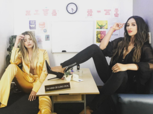 Ashley Benson Pretty Little Liars star Ashley Benson hung out at Facebook with costar Shay Mitchell, and of course the pair took the requisite photo in the HQ's mini office. While Benson wore a yellow silk pantsuit, Mitchell opted for an all-black ensemble.