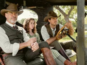 Pierce Brosnan as Eli McCullough, Sydney Lucas as Jeannie McCullough, Henry Garrett as Pete McCullough in The Son.