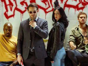 Mike Colter as Luke Cage, Charlie Cox as Matt Murdock, Krysten Ritter as Jessica Jones and Finn Jones as Danny Rand.