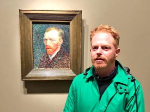Modern Family actor Jesse Tyler Ferguson poses with a self-portrait by Vincent van Gogh at the Art Institute of Chicago.