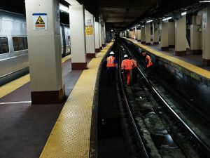 NEW YORK, NY - Track maintenance workers walk along train tracks used by both New Jersey Transit and Amtrak trains at Pennsylvania Station.