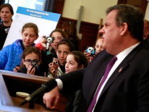 Gov. Chris Christie, a bunch of schoolgirls, and some charts.