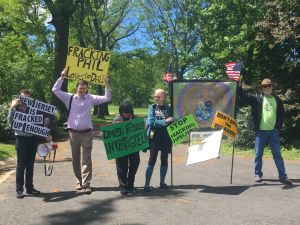 A group of protestors raised issue with Murphy's investments.