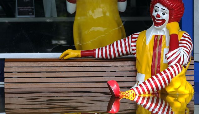 A statue of Ronald McDonald sits outside the fast food chain in floodwater in Bangkok on October 24, 2011. Millions of people in the Thai capital nervously prepared for the advancing and seemingly unstoppable flood waters after a fresh warning for residents to evacuate certain danger zones. AFP PHOTO / Pornchai KITTIWONGSAKUL (Photo credit should read PORNCHAI KITTIWONGSAKUL/AFP/Getty Images)
