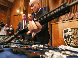 Former NYPD Commissioner Raymond Kelly lifts an illegal gun purchased in South Carolina and smuggled into New York.