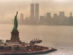 A picture taken 20 May 1986 in New York shows the Statue of Liberty and the Twin Towers of the World Trade Center in the background. (