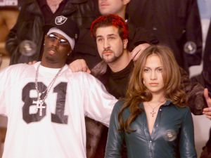 """Los Angeles, CA, February 21, 2000 - MTV: MUSIC TELEVISION brought together Grammy-nominated artists for a special edition of """"Total Request Live"""" and a unique photo shot by David LaChapelle. Many of these artists became stars or enjoyed even greater popularity through their exposure on """"TRL."""" The """"TRL"""" class photo will be turned into a poster and sold via MTV.com with proceeds going to charity. L-R: Sean """"Puffy"""" Combs, Joey Fatone of 'NSYNC, and Jennifer Lopez pose for the photo. Other artists participating in the shoot included Britney Spears, Limp Bizkit, Christina Aguilera, Lenny Kravitz, Tyrese, Destiny's Child and Goo Goo Dolls."""